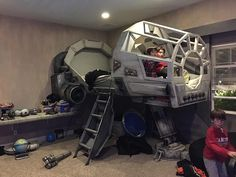 Impressive Custom-Built 'Star Wars' Bedroom Featuring a Kid's Bed Made of a Millennium Falcon Cockpit & an AT-AT Leg