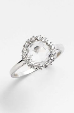 KALAN by Suzanne Kalan 'Starburst' Round Bezel Ring. Prong-set sapphires burst forth in sparkling splendor from the faceted topaz stone topping a handcrafted white-gold ring.