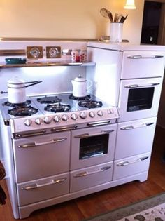 1951 Aristocrat O'Keefe & Merritt 6 burner stove with three ovens, warming drawer and separate broiler. Be still my heart.