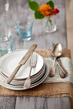 Simple Place Settings with a paisley-patterned napkin on a Burlap Table Runner