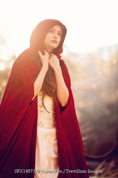 Trevillion Images - woman-in-sun-light-with-red-cloak
