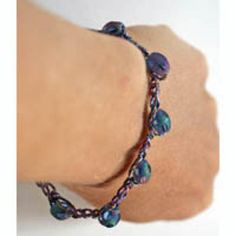 19 Free Crochet Jewelry Patterns You Should Check Out: Blue and Purple Crocheted Bracelet With Cathedral Beads