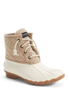 Staying stylish even in wet terrain with these weather-resistant Sperry duck boots that helps keep feet dry, while the quilted wool shaft and a microfleece lining add rainy-day warmth.
