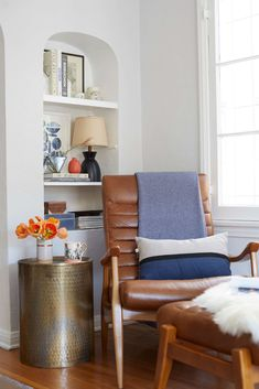 Get inspired by Eclectic Living Room Design photo by Style by Emily Henderson. Wayfair lets you find the designer products in the photo and get ideas from thousands of other Eclectic Living Room Design photos. Mid Century Leather Chair, Leather Wingback Chair, Leather Lounge, Leather Chairs, Swivel Chair, Eclectic Living Room, Living Room Chairs, Living Room Designs, Living Room Furniture