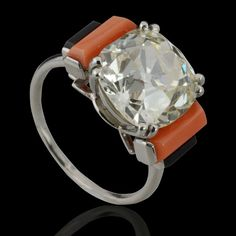 Fine Art Deco 6.30ct Old mine cushion cut diamond ring with faceted coral & back onyx shoulder stones by Cartier, Paris c1930.
