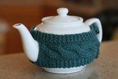 Cable knit tea pot cozy, might fit my squat cast iron tea pot?