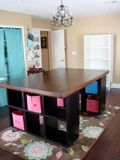 do something like this instead of a room dividing island? use a skinnier table top and only 2x2 bookshelf units??