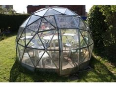 A geodesic greenhouse for those of circular vision & Charter-Sphere Dome designed by TC Howard of Synergetics Inc ...