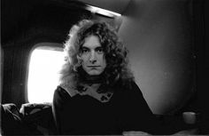 "Robert Plant of Led Zeppelin aboard the band's private jet, ""The Starship"