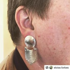 The finished sterling silver earrings, designed and handmade by @eloise.forbes in the Design Your Own Silver Earrings Workshop.