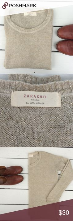 Zara Knit Sparkly Sweater Zara knit crew neck sweater. This awesome sweater is perfect for the upcoming holiday season. Pair with skinnies and a sparkly necklace and you ready. Slightly oversized. In good condition, some slight pilling. Zara Sweaters Crew & Scoop Necks