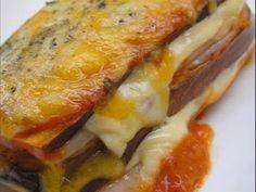 Berenjena con jamón y queso / Berenjenas - lonchas de jamón cocido o pechuga de pavo - lonchas de queso - salsa de tomate casera - queso rallado ( 4 quesos) - orégano.