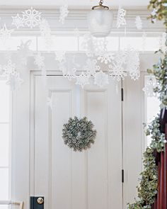 Overhead snowflake decorations for the entryway.