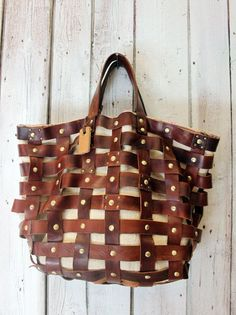 """INTRECCIATO 27"" is a beautiful handmade woven leather bag .This bag is unique and finely crafted with attention to detail. A bag that can take you anywhere. It can be worn on the shoulder:to take you from work to dinner or from town to country. Like all bags from La Sellerie Limited, also this bag is one of a kind and is handmade in Italy. 37cm 45cm 15cm free shipping"