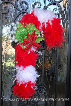 Cute alternative to a wreath...a foam tube and a red and white boa.