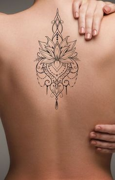 Bohemian Lotus Back Tattoo Ideas for Women - Feminine Tribal Flower Chandelier Jewelry Spine Tat - Ideas de tatuaje de espalda de mujer - www.MyBodiArt.con #tattoos