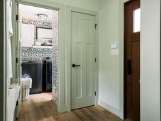 Proximity to entry - so doubles as mud room, too.  Great use of space. Someday, in my imaginary weekend house in the country.  : )