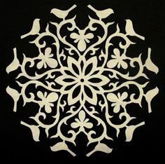 The Quilt Rat: Cutting Paper Snowflakes: How to make this beautiful scissor art piece and put it on your quilt.