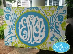 Had this made for Evie's room.  Monogram Damask Canvas by mcleansa on Etsy, $85.00