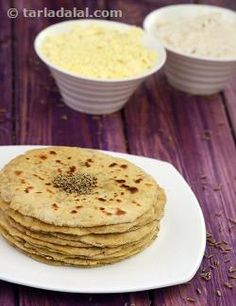 These are a regular part of a Rajasthan meal and sometimes variations are made by adding methi leaves or coriander leaves to flavour the dough. Missi Rotis are eaten throughout the year except in the winters when bajra rotis are preferred. Serve these with a spicy vegetable or a tongue tickling launji to make a delicious meal. Puri Recipes, Paratha Recipes, Indian Food Recipes, Snack Recipes, Ethnic Recipes, Snacks, Indian Breakfast, Perfect Breakfast, Breakfast Dishes