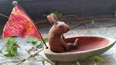 Check out this item in my Etsy shop https://www.etsy.com/listing/291976805/ceramic-rabbit-in-boat-with-sari-pennant