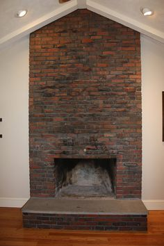 How to cover a fireplace using sheet rock for the home - Floor to ceiling brick fireplace makeover ...