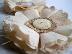 muslin & burlap flowers  i'm thinking altered a bit and making angels!!