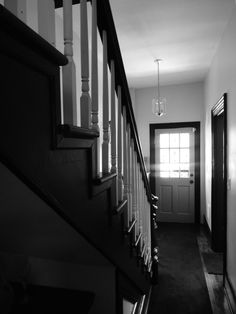 Restored hallway! 100 year old house in S.E. Washington, DC. Photography by Bonnie Wellman .