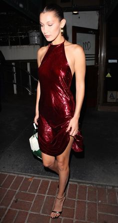 Bella Hadid stunned in this red sequin dress... her looks lately have been nothing short of amazing...talk about street style