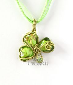 St. Patricks Day inspired pendant, made of lampwork glass heart beads and enamel plated wire.  Made with a time consuming wire wrapping technique.