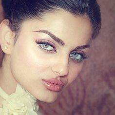 Rahi Jaberi a persian model with an extremely unique face. Big eyes, big lips, striking face unique ethnic exotic