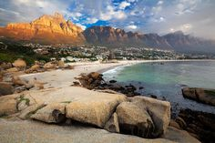 landscape photo of camps bay and the twelve apostles behind it
