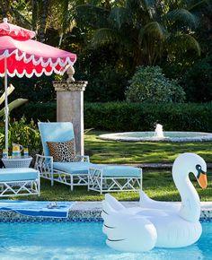 Pretty pink umbrella? Check. Leopard print pillows? Check. Swan pool float friend? Check!