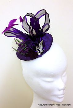 Purple Scottish heather fascinator with purple tweed, feathers and silver brooch.  www.margaretalicefascinator.co.uk