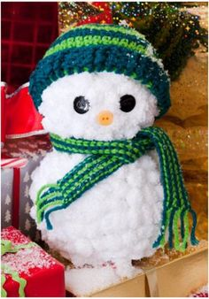 This Easy Yarn Snowman with Crocheted Hat and Scarf from Red Heart Yarn is so easy to make!  Christmas decorations don't have to break the bank...you can make them yourself!  Plus this snowman craft can stay up all winter long!
