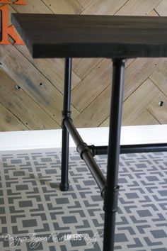 LOVE IT!  DIY Pipe Table--full tutorial by Designer Trapped in a Lawyer's Body.  #pipetable maybe even for my office.