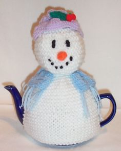 The Snowlady Tea Cosy is lovely and festive with her carrot nose and holly berry adorned hat  http://www.teacosyfolk.co.uk/Snowlady-Tea-cosy-p-3.php