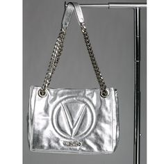 NWT VALENTINO LUISA LEATHER METALLIC HANDBAG SILVR This is not a bag that goes unnoticed :-) a bold quilted silver metallic with a chain & leather strap 13 inch drop. Top magnetic snap closure. Inside open pocket inside zipper pocket, twill lining. 13 inch Width x 10 inch Height x 6 inch Depth. 100% authentic, purchased from Nordstrom. Includes original dust bag. Italian leather. Hope you love it as much as we do – Xo! Valentino Bags