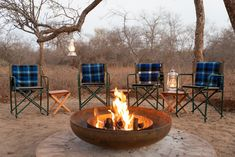 Fire pit boma with camping chairs and traditional African blankets Safari Decorations, Camping Chairs, Blankets, Villa, African, Fire, Traditional, Outdoor Decor, Green