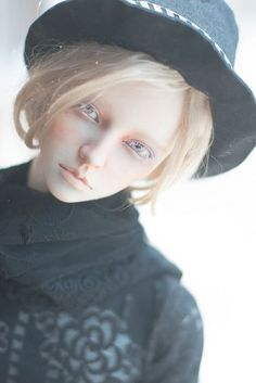 blonde male doll with hat