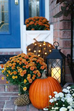 Pre-lit twig pumpkins, jack-o'-lanterns and colorful mums line up the entryway.