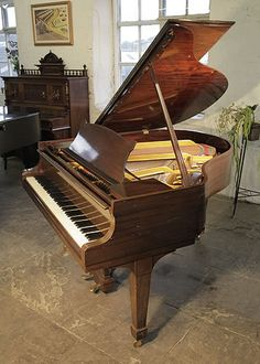 An unrestored, 1938, Steinway Model S baby grand piano for sale with a mahogany case and spade legs at Besbrode Pianos. Piano has an eighty-eight note keyboard and a two-pedal lyre.