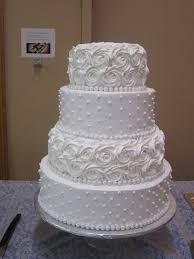 The three tiered wedding cake and two full sheet cakes served over ...