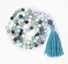 Mala of mixed gemstones including; Amazonite, Blue Lace Agate, Clear Quartz, Sodalite & Howlite. Inspired by our love of the Indian Ocean, this mala is close to our hearts. Finished with a coral guru bead and hand-made tassel.  Each Mala is hand-knotted with 108 beads gemstone beads. Blue Gemstones, Gemstone Beads, Natural Gemstones, Blue Lace Agate, Coral Blue, Metal Beads, Clear Quartz, Tassel Necklace, Hearts