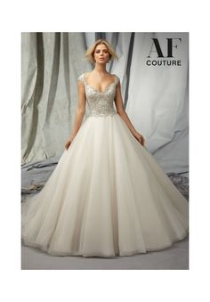 Bridal Gowns By AF Couture featuring 1310 Elaborately Beaded Embroidery on a Tulle Bridal Gown Colors Available: White, Ivory, Light Gold. Sizes Available: 2-28.