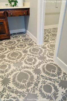 John and Sherry from Young House Love stenciled our Silk Road Suzani pattern on a bathroom subfloor as an inexpensive alternative to new flooring. The look? Priceless.
