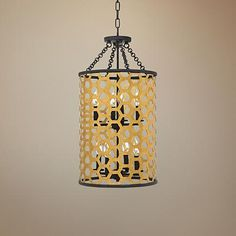Decorate your entry with the incomparable sophistication of this gold finish contemporary 8-light pendant with a honeycomb steel shade.