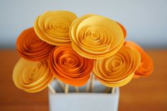 How to make paper flowers - These rolled paper flowers are super easy and surprisingly fun to make! Here's an easy tutorial to get you started.