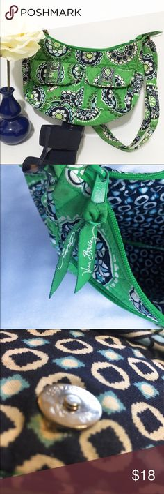 """Retired Vera Bradley Cupcakes Green Bag A beautiful classic bag in retired Vera Bradley Cupcakes Green print. Bag has two front pockets and a bag side zippered pocket. Main compartment has zipper closure and three inside pockets. 100% Cotton.   Size Medium  Measurements (laid flat) 10"""" x 6"""" x 3"""" Adjustable shoulder drop 14"""" or longer   Condition Well maintained bag. Shows minor signs of wear and 2 pink dots. Flaws shown in pictures. Small fabric tear at enclosure magnet (interior flaw)…"""