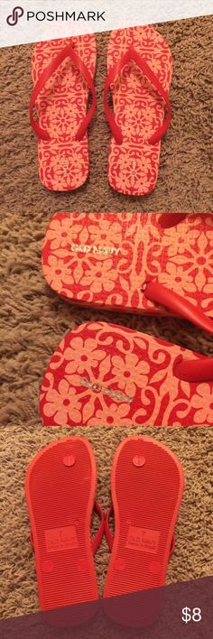 """Old Navy bright red floral pattern flip flops These are a super cute pair of Old Navy flip flop sandals. They are several years old but are very lightly worn. The patterned part still looks like new, and the soles are very clean. I'm guessing they were my """"around the house shoes"""" for a little while and might've been worn out in the yard a time or two. The color is a bright red, and the floral part is a lighter red that looks a little more pinkish. Old Navy Shoes Sandals"""